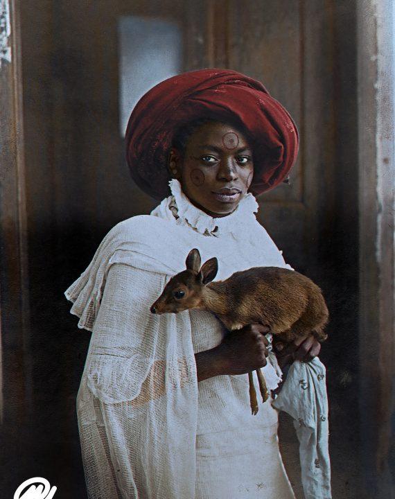 Young Kenyan Woman Holding A Dik-Dik, Mombasa; 1909